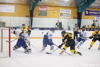 Toronto Furies defender Ella Stewart (22) gets enough of her stick in the way to make Boston Blades forward Michelle Ng's (5) shot go wide