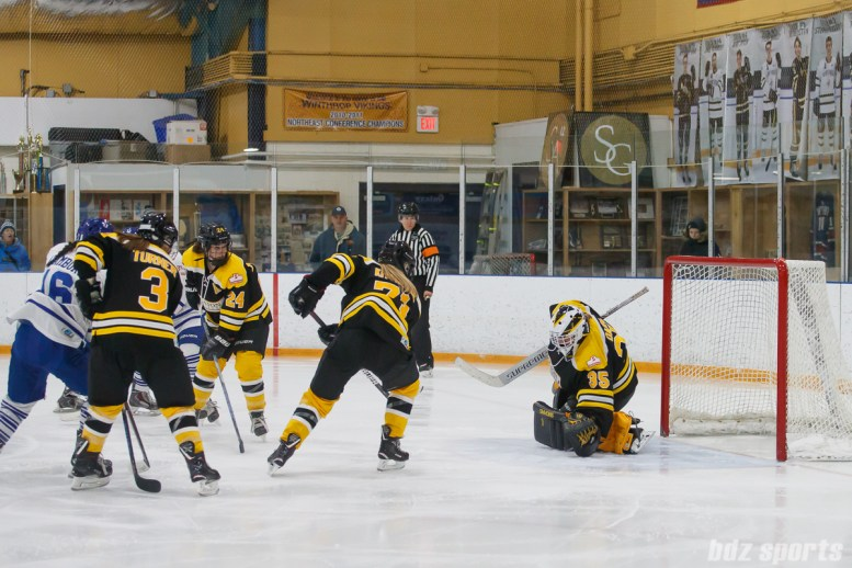 Boston Blades goalie Lauren Dahm (35) comes up with the glove save