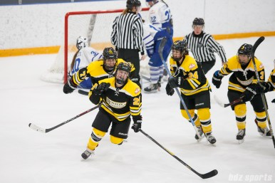 Boston Blades forward Kate Leary (28) is all smiles after scoring Boston's fourth goal of the game
