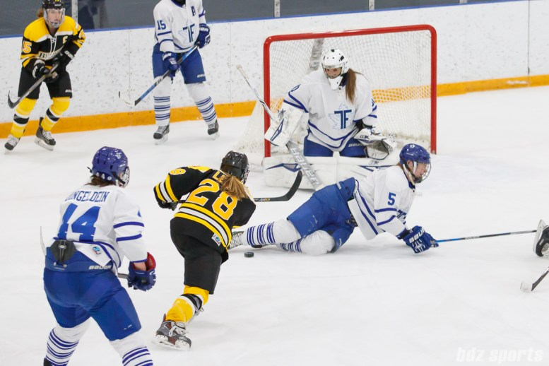Toronto Furies defender Michelle Saunders (5) uses her body to block Boston Blades forward Kate Leary's (28) shot on goal