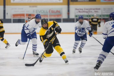 Boston Blades forward Erin Kickham (6) takes a shot on goal