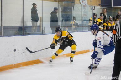 Boston Blades forward Megan Myers (15) sends the puck around