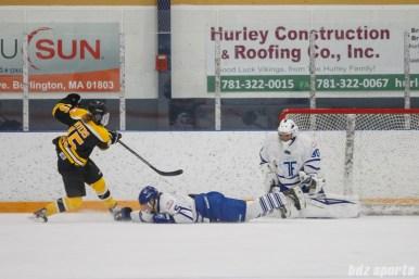 Toronto Furies goalie Sonja van der Bliek (30) blocks the shot from Boston Blades forward Megan Myers (15)
