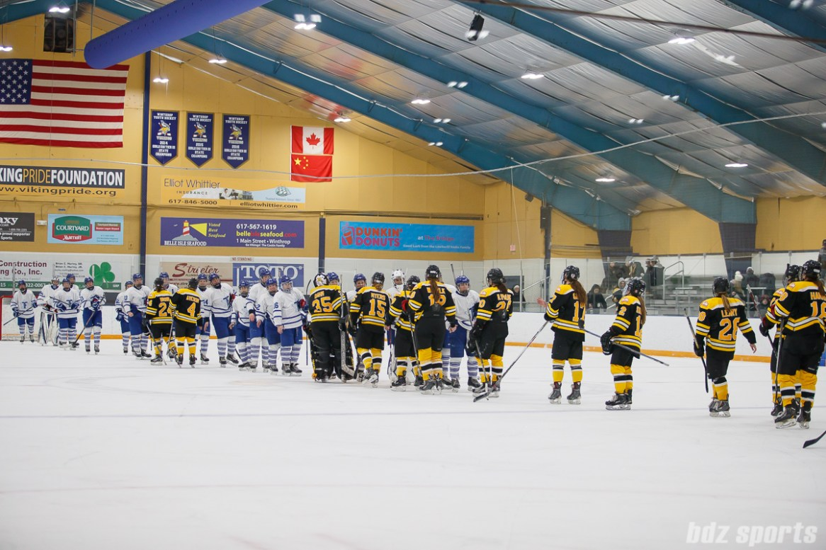 The Toronto Furies and Boston Blades shake hands after the Furies came back from behind to win the game 2-1 over the Blades