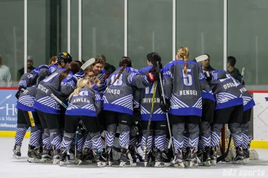 Team NWHL huddles before the start of the game