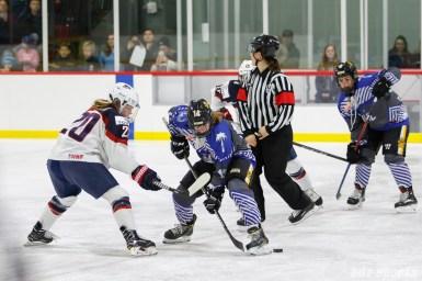 Team NWHL forward Jillian Dempsey (14) wins the opening face off against Team USA forward Hannah Brandt (20)