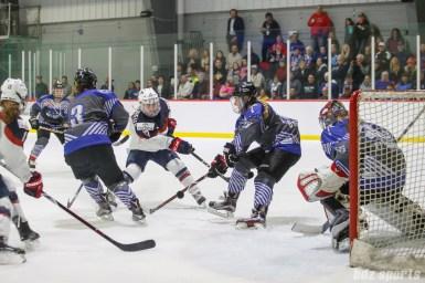 Team NWHL forward Alexa Gruschow (16) blocks the shot by Team USA forward Jocelyne Lamoureux-Davidson (17)