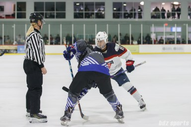 Team USA defender Gigi Marvin (19) prepares to take the faceoff