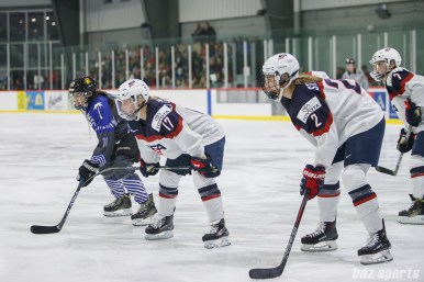 Team NWHL forward Jordan Smelker (11) and Team USA players Jocelyne Lamoureux-Davidson and Lee Stecklein line up during a faceoff