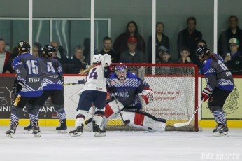 Team NWHL goalie Katie Fitzgerald (35) tracks the puck in front of Team NWHL goal