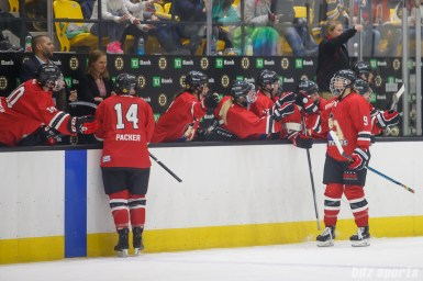 Metropolitan Riveters defender Rebecca Morse (9) high fives the bench after scoring the Riveters' fourth goal of the game
