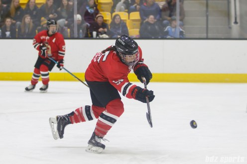 Metropolitan Riveters defender Kelsey Koelzer (55) dishes off the puck