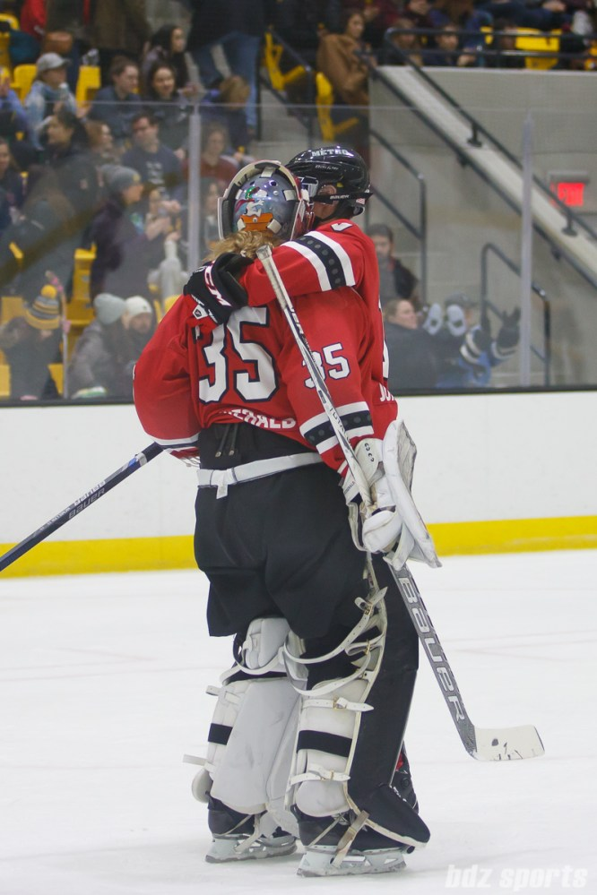 Metropolitan Riveters defender Ashley Johnston (10) congratulates goalie Katie Fitzgerald (35) after the Riveters defeated the Pride 5-1