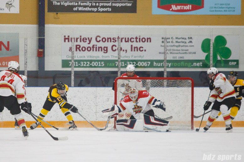 Boston Blades forward Meghan Grieves (17) looks to slip the puck past Kunlun Red Stars goalie Noora Raty (41)
