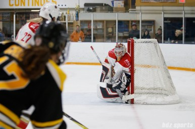Kunlun Red Stars goalie Noora Raty (41) blocks an incoming shot