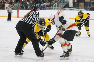 Boston Blades forward Melissa Bizzari (23) takes the faceoff for the Blades