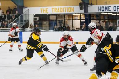 Boston Blades forward Courtney Turner's (3) shot on goal gets deflected by Kunlun Red Stars forward Kelli Stack (16)
