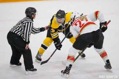 Boston Blades forward Melissa Bizzari (23) takes the faceoff against Kunlun Red Stars forward Shiann Darkangelo (27)