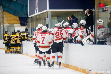 The Kunlun Red Stars gather at the bench during a timeout