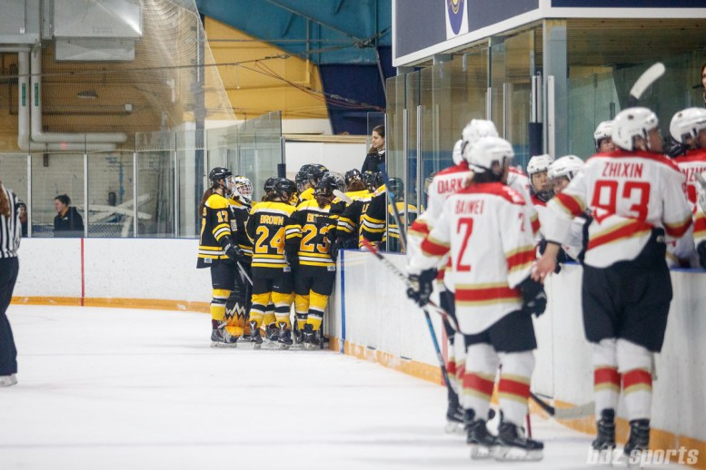 The Boston Blades huddle at the bench during a timeout