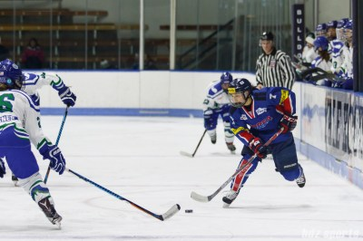 Team South Korea forward Jin Kyoung Im (7) controls the puck for South Korea