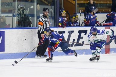 Team South Korea defender Su Yeon Eom (3) brings the puck down the ice
