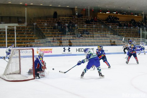 Connecticut Whale forward Grace Klienbach (94) redirects the puck into the back of the net