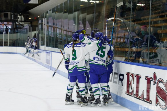 Connecticut Whale players celebrate their fourth goal of the game