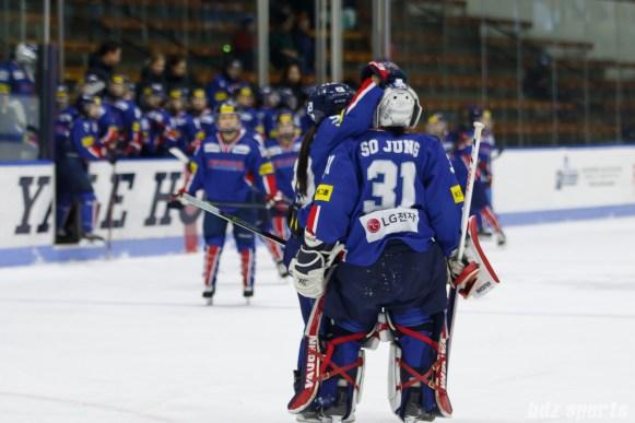 Team South Korea forward Jin Gyu Lee (29) hugs goalie So Jung Shin (31) after the game