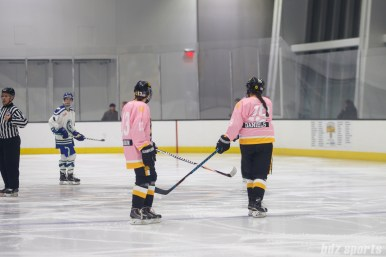 Boston Pride forwards Kaleigh Fratkin (13) and Sydney Daniels (19) tap sticks before play restarts