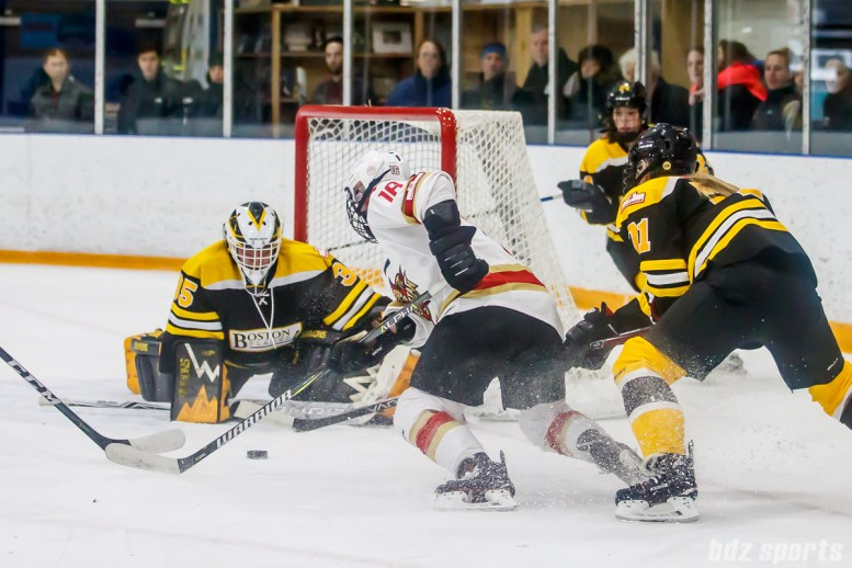 The puck is loose in front of the Boston Blades goal