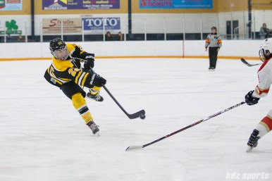 Boston Blades forward Chelsey Goldberg (22) takes a shot on goal