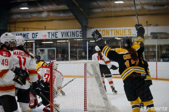 Boston Blades forward Meghan Grieves (17) celebrates a goal by teammate defender Dru Burns (not pictured)
