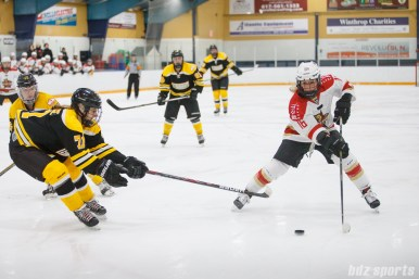 Kunlun Red Star forward Kelli Stack (16) controls the puck while being challenged by Boston Blades defender Kelly Kittredge (71)