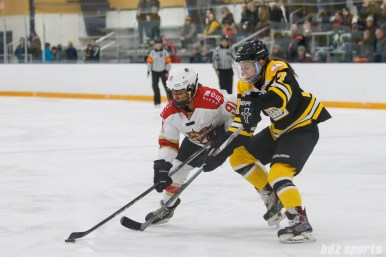 Boston Blades forward Meghan Grieves (17) challenges Kunlun Red Star forward Rachel Llanes (91) for the puck