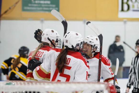 Kunlun Red Star Madison Woo (15) and Zhixin Liu (93) celebrate temmate Shiann Darkangelo's (27) goal in the third period