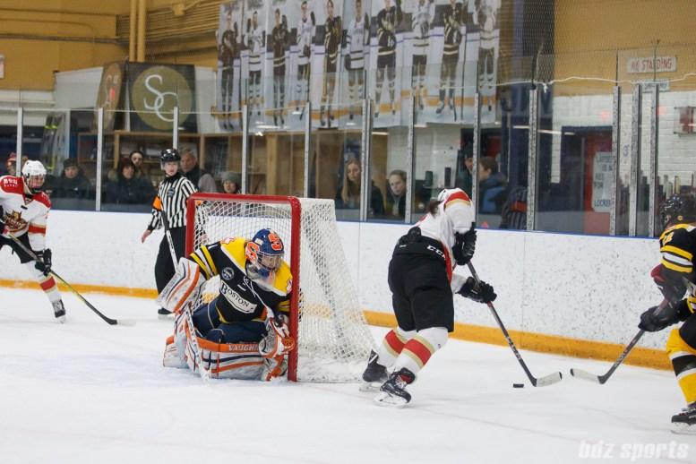 Boston Blades goalie Amanda Cariddi (1) tracks the puck as it goes around the goal