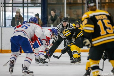Montreal Les Canadiennes forward Noemie Marin (10) and Boston Blades forward Courtney Turner (3) take a faceoff