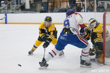 Boston Blades defender Sato Kikuchi (8) clears the puck out of danger