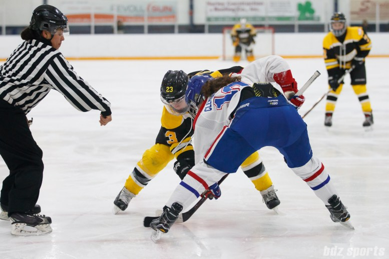 Boston Blades forward Melissa Bizzari (23) takes the face off against Montreal Les Canadiennes forward Katia Clement-Heydra (19)