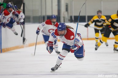 Montreal Les Canadiennes forward Kayla Tutino (88) chases down a puck