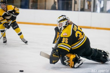Boston Blades goalie Lauren Dahm (35) pushes away the puck