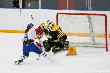 Montreal Les Canadiennes forward Katia Clement-Heydra (19) attempts to beat Boston Blades goalie Lauren Dahm (35) on a shootout attempt