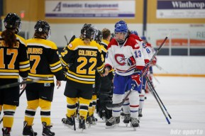 Montreal Les Canadiennes forward Caroline Ouellette (13) shakes hands with the Boston Blades post-game