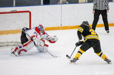Montreal Les Canadiennes goalie Emerance Maschmeyer (38) prepares to block the shootout attempt by Boston Blades forward Kate Leary (28)