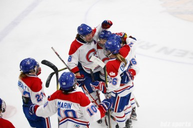 The Montreal Les Canadiennes celebrate their shootout win over the Boston Blades