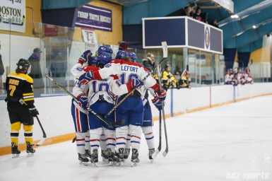 The Montreal Les Canadiennes congratulate forward Ann-Sophie Bettez (24) after scoring the game's first goal