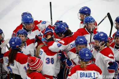 Montreal Les Canadiennes defender Cathy Chartrand (8) congratulates goalie Emerance Maschmeyer (38) after the Les Canadiennes shootout win over the Blades