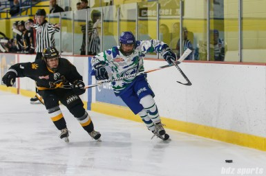Connecticut Whale forward Sam Faber (28) chases down a puck against Boston Pride forward Kaleigh Fratkin (13)