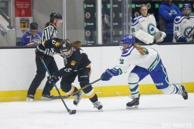 Boston Pride forward Emily Field (15) and Connecticut Whale defender Jordan Brickner (26)